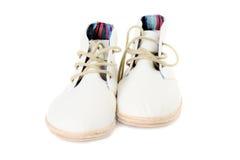 Paia delle scarpe di tela d'avanguardia isolate sulla parte anteriore bianca Fotografie Stock