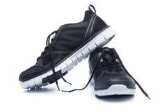 Paia delle scarpe nere di sport, scarpe da tennis Immagini Stock