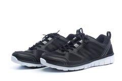 Paia delle scarpe nere di sport, scarpe da tennis Fotografie Stock