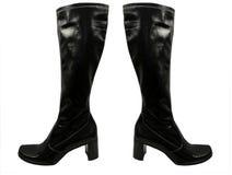 Paia isolate degli stivali di cuoio del nero del ginocchio su con i tacchi alti Fotografie Stock