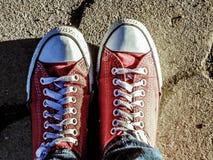 Paia rosse delle scarpe da tennis Fotografia Stock