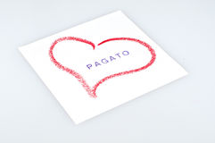 Paid. Sheet with heart drawn with lipstick and writing paid Stock Photography