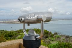 Paid binocular telescope on the tip of the Point Loma Peninsula in San Diego, California, USA. Close image of automated binoculars to observe San Diego city & royalty free stock image