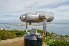 Paid binocular telescope on the tip of the Point Loma Peninsula in San Diego, California, USA. Close image of automated binoculars to observe San Diego city & royalty free stock photography
