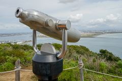 Paid binocular telescope on the tip of the Point Loma Peninsula in San Diego, California, USA. Close image of automated binoculars to observe San Diego city & stock photos