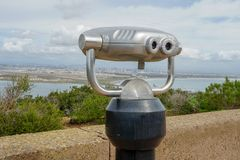 Paid binocular telescope on the tip of the Point Loma Peninsula in San Diego, California, USA. Close image of automated binoculars to observe San Diego city & stock photography