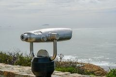 Paid binocular telescope on the tip of the Point Loma Peninsula in San Diego, California, USA. Close image of automated binoculars to observe San Diego city & stock photo