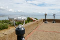 Paid binocular telescope on the tip of the Point Loma Peninsula in San Diego, California, USA. Close image of automated binoculars to observe San Diego city & royalty free stock images