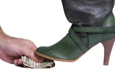 A Paid Boot 2. A person giving money for something less than legal...a sexy boot steps on top of it Stock Photos