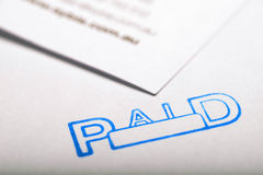 Paid 2. Document and paid stamp for filing of records stock photos