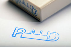 Paid 1. Document and paid stamp and stamper for filing of  records Stock Photo