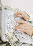 Paid job: Female hands typing on white computer keyboard Stock Photo