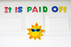 It is Paid Off message is on a front door of house Stock Photo