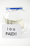 Paid Off Your Debt. Jar With Money And IOU Paid Sign Royalty Free Stock Photo