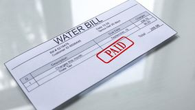 Paid seal on water bill, payment for services, month expenses, tariff close up. Stock photo vector illustration