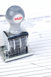 Paid stamp on invoice. Dated paid business stamp on invoice stock photography