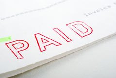 Paid Stamp on Invoice. Macro of Paid stamp on invoice, shallow DOF Royalty Free Stock Images