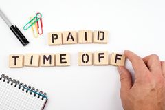 Paid time off. Wooden letters on a white background Royalty Free Stock Photography
