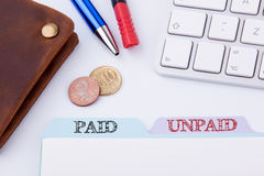 Paid and Unpaid. Folder Register on a white Office Table.  royalty free stock photos
