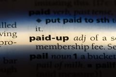 Paid up. Word in a dictionary.  concept royalty free stock images