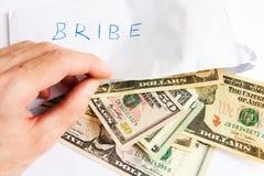 Paiement illicite en dollars Images libres de droits