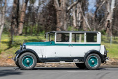 1926 Paige Sedan driving on country road Stock Photography