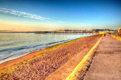 Paignton beach Devon England colourful HDR on warm summer morning with blue sky Royalty Free Stock Images
