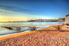 Paignton beach Devon England colourful HDR on warm summer morning with blue sky Stock Images