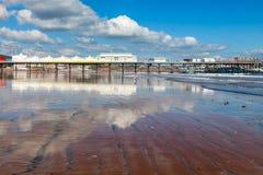 Paignton Beach Devon England. Paignton pier reflected in the wet and on the Beach Devon England UK Europe stock photos