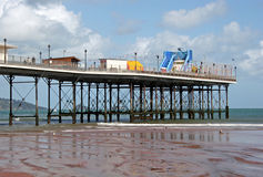 Paignton pier. From beach at low tide Royalty Free Stock Images