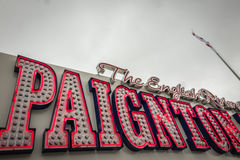 Paignton pier detail. Close up of the letters spelling Paignton on the Paignton pier amusement arcade on a cloudy, stormy day Royalty Free Stock Images