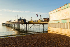 Paignton pier and sandy beach Torbay Devon in summer 2013 Royalty Free Stock Image