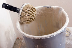 Pail and brushes. Dirty pail and black brushes stock photo