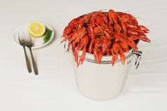 Pail full of river lobster served on table. With lemon royalty free stock photos