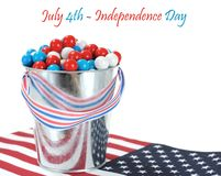 A pail of gummy ball candy. In a Fourth of July decoration isolated on white royalty free stock photos