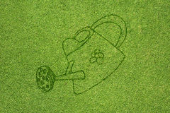 Pail icon on green grass Stock Image