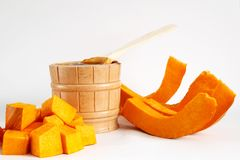 Pail and pumpkin Stock Images