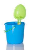 Pail and Shovel Beach Toy. Blue pail and green shovel beach toy Royalty Free Stock Images