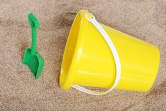 Pail And Shovel In The Sand. Closeup of a child's Pail And Shovel In The Sand stock image