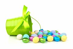 Pail and spilling Easter candy Royalty Free Stock Photography