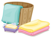 A pail with towels and a soap in a soap box Royalty Free Stock Images
