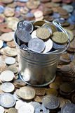 Pail of world coins Royalty Free Stock Image