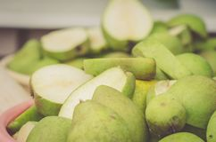 pailful of the ripe cut pears/pailful of the ripe cut pears, selective focus royalty free stock image