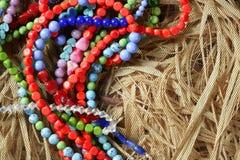 paille de pierres de colliers de bijou de couleur de fond Images stock