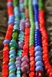 paille de pierres de colliers de bijou de couleur de fond Photographie stock libre de droits