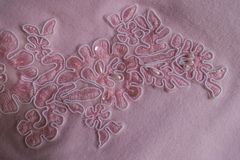 Paillettes, beads and embroidery on pink fabric. Paillettes, pearl beads and embroidery on pink fabric Royalty Free Stock Photos