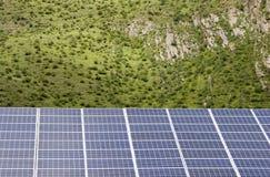 Painéis solares e árvores imagem de stock royalty free