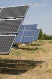 Painéis solares no campo Imagens de Stock