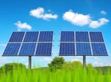 Painéis solares no prado Fotos de Stock Royalty Free
