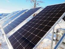 Painéis solares pequenos fotos de stock